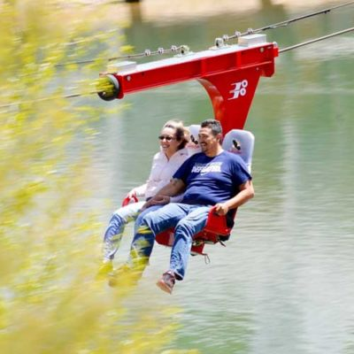 2 people on the Red River zip line
